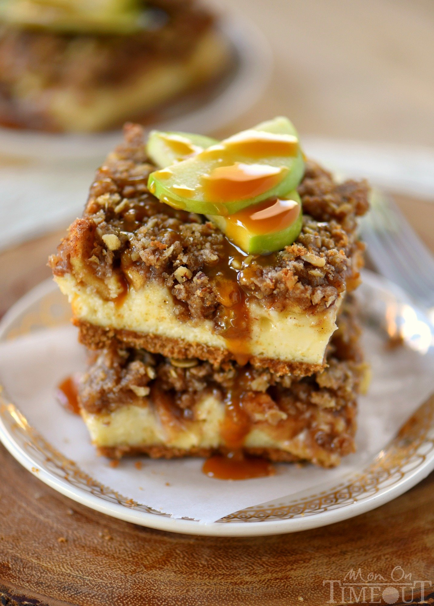 Apple season has arrived and to celebrate, I'm sharing these outrageous Dutch Apple Pie Cheesecake Bars! A graham cracker crust spiced with cinnamon, a decadent vanilla bean cheesecake layer, apples tossed in sugar, cinnamon, and nutmeg and finally my favorite streusel topping. Yeah, WOW. | Mom On Timeout