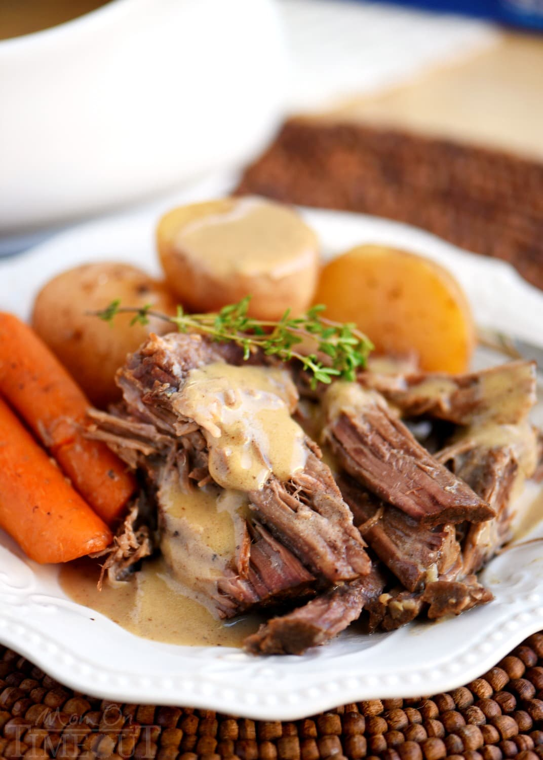 pot roast recipe with gravy on plate with potatoes and carrots