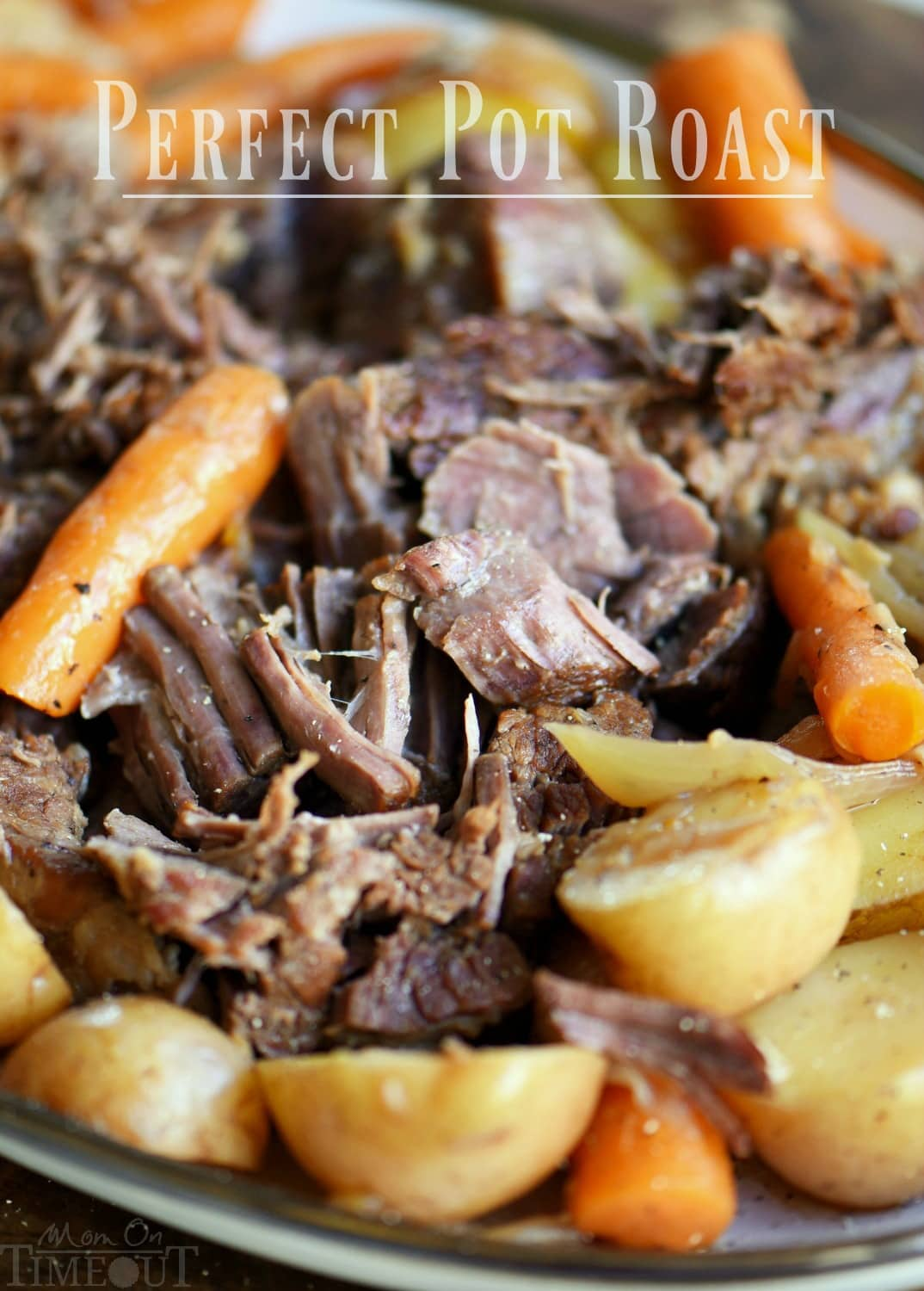 pot roast beef shredded with veggies on platter
