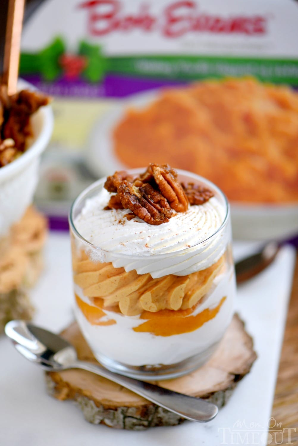The best dessert I've had all year - Sweet Potato Cheesecake Parfaits! Layers of gingersnap cookies, marshmallow, sweet potato cheesecake and whipped cream all topped with candied pecans and a dash of cinnamon! Delight in every bite! // Mom On Timeout