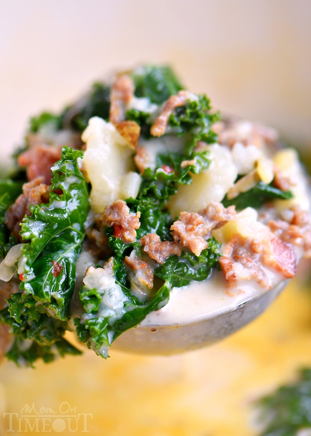 zuppa toscana soup in ladle with kale and potatoes