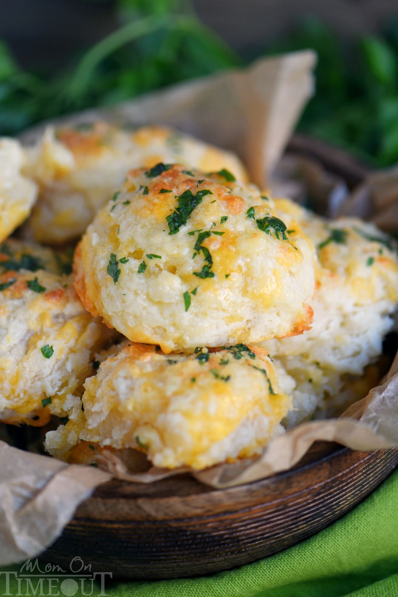 These Cheddar Bay Biscuits (Red Lobster Copycat) are entirely irresistible and can be on your table in less than 20 minutes! I dare you to eat just one! Packed with cheesy goodness, these easy biscuits are the perfect addition to every meal! // Mom On Timeout