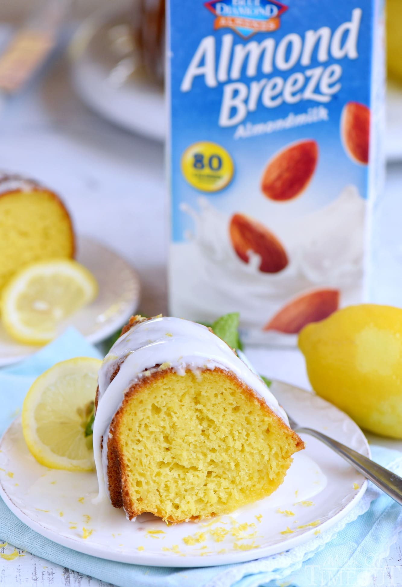 Looking for an easy lemon dessert recipe that is going to WOW your friends and family? This Easy Lemon Bundt Cake is the answer! A breeze to make and loaded with bright lemon flavor, this easy cake recipe is also figure-friendly which makes it perfect for summer! // Mom On Timeout