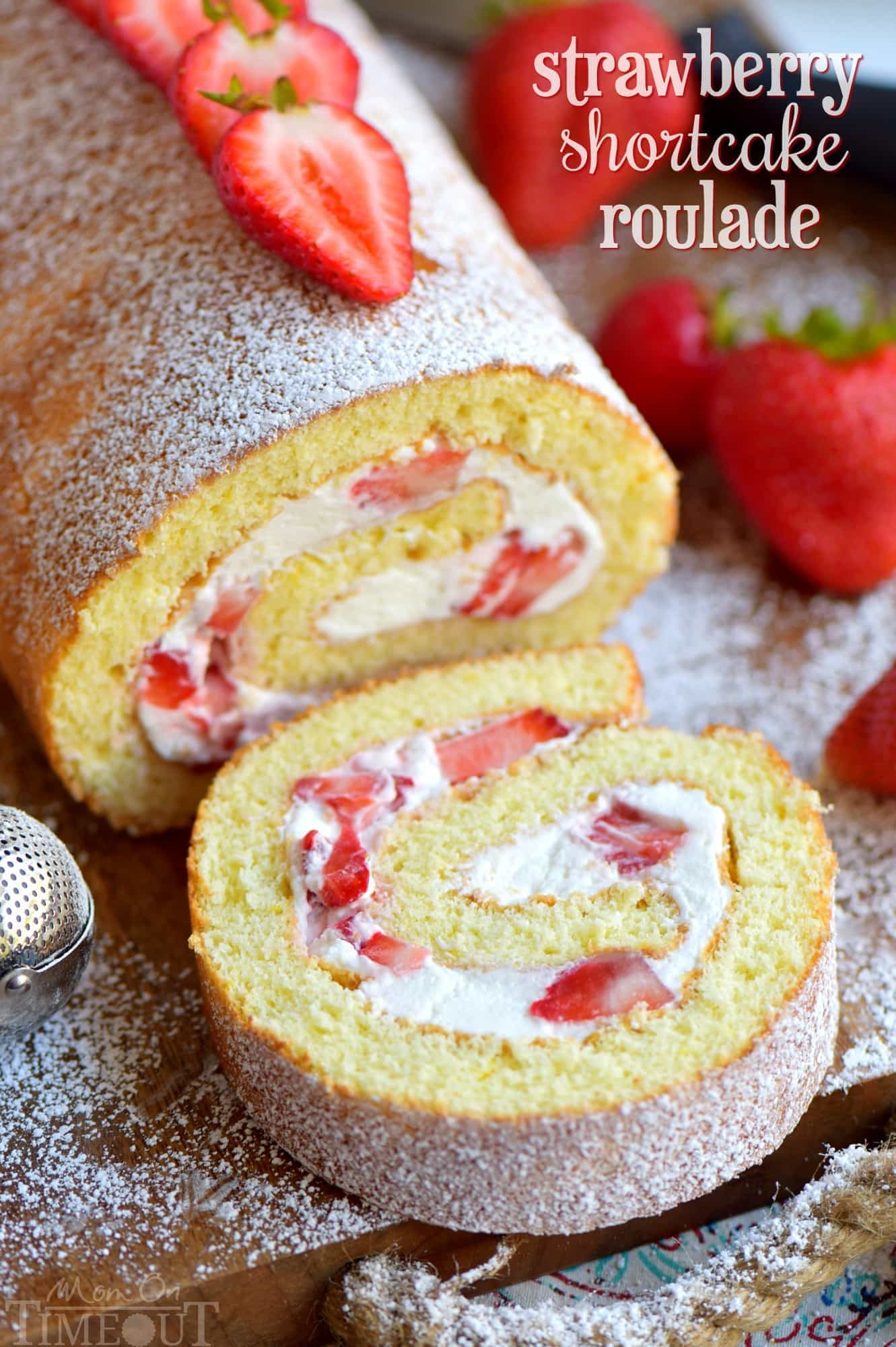 This Strawberry Shortcake Roulade is the quintessential summer dessert. Cake rolls are always stunning but this one is particularly so. Light and airy cake wrapped around a sweet whipped cream and fresh strawberry filling. Irresistible! // Mom On Timeout