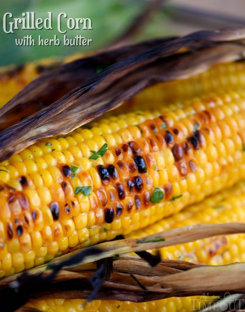 Nothing says summer like corn on the cob! This Grilled Corn with Herb Butter is sure to be a delightful addition to your summer menu. So easy to prepare and always a big hit with friends and family! // Mom On Timeout