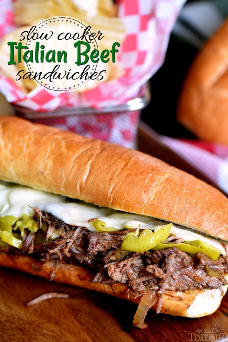 italian-beef-recipe-in roll- with cheese-and peppers on cutting board