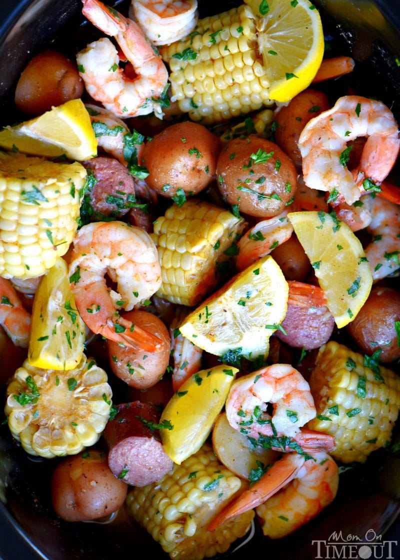 This easy Slow Cooker Shrimp Boilis the perfect busy weeknight dinner recipe! Made with just a handful of ingredients and exploding with delicious, fresh flavor, it's sure to become an instant favorite with your family! // Mom On Timeout
