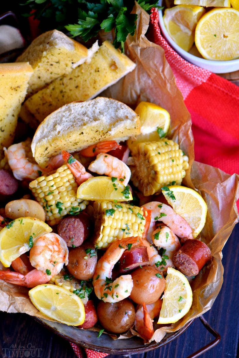 This easy Slow Cooker Shrimp Boilis the perfect busy weeknight dinner recipe! Made with just a handful of ingredients and exploding with delicious, fresh flavor, it's sure to become an instant favorite with your friends and family – it certainly was with mine! // Mom On Timeout