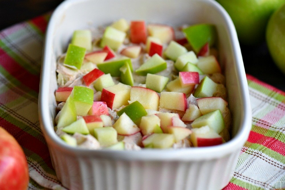 ingredients in baking dish topped with apples