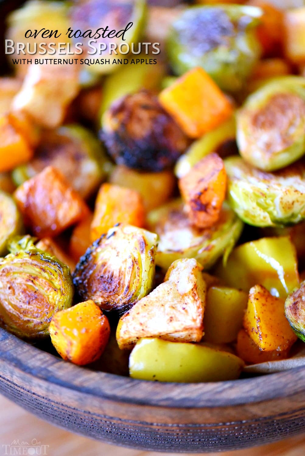 Oven Roasted Brussels Sprouts with Butternut Squash and Apples are liberally spiced with ground cinnamon and chili powder for a fantastic explosion of flavor. Perfect for the holidays! This dish is a celebration of those amazing flavors that can only be found in the fall.  An easy side dish that is perfect for any night of the week. Whole30 compliant. // Mom On Timeout