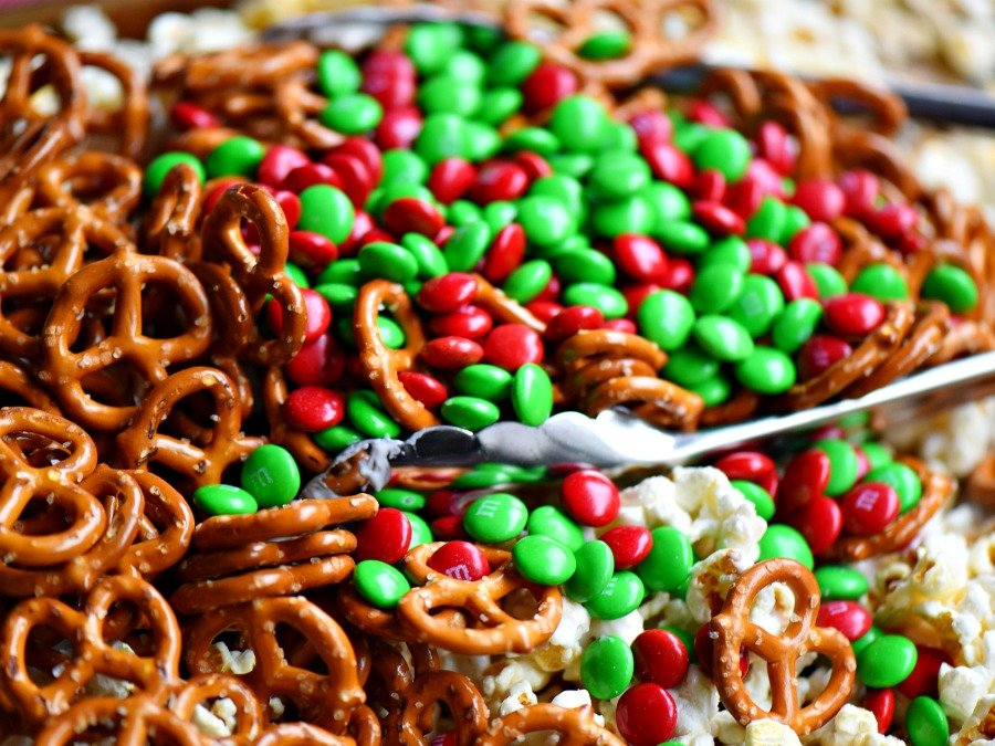 This wonderfully festive Christmas Snack Mix is the perfect easy treat all winter long! Both sweet and salty, this holiday snack mix is great for Christmas, movie nights, parties, gifts and so much more! // Mom On Timeout