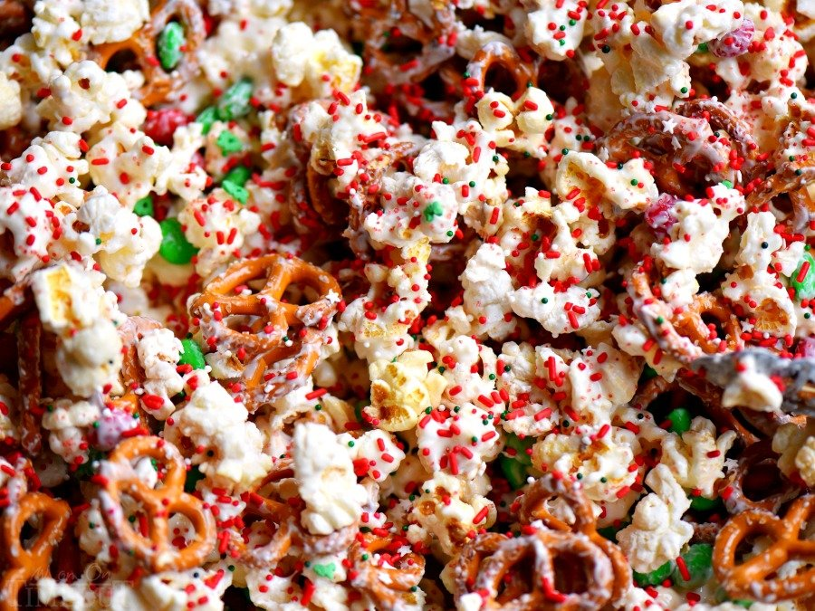 This wonderful holiday Snow Day Snack Mix is the perfect easy treat all winter long! Both sweet and salty, this holiday snack mix is great for Christmas, movie nights, parties, gifts and so much more! // Mom On Timeout #christmas #dessert #snack #pretzels #marshmallows #redandgreen #momontimeout