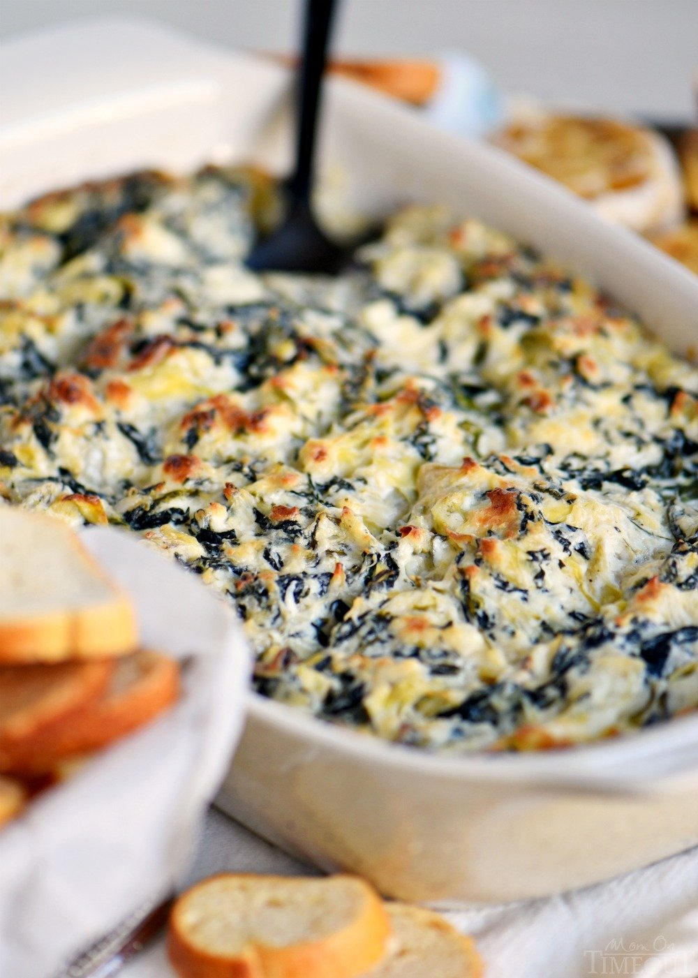 best-spinach-artichoke-dip-in-dish-with-spoon