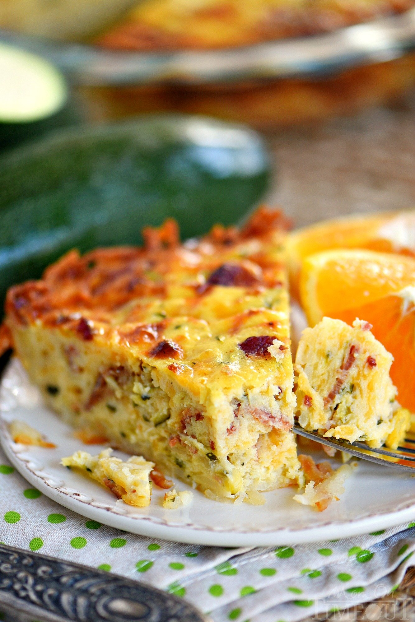 slice-zucchini-quiche-with-bacon-hash-brown-crust-recipe