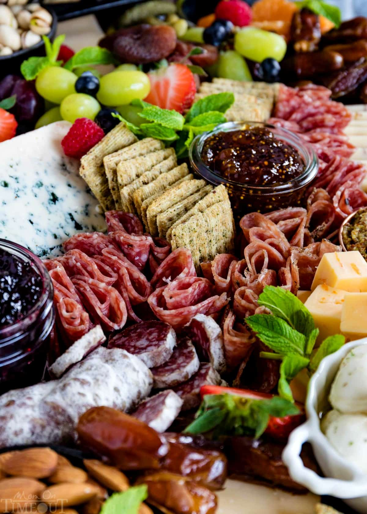 charcuterie-board-easy-cured-meats-dried-fruits-almonds-bowls