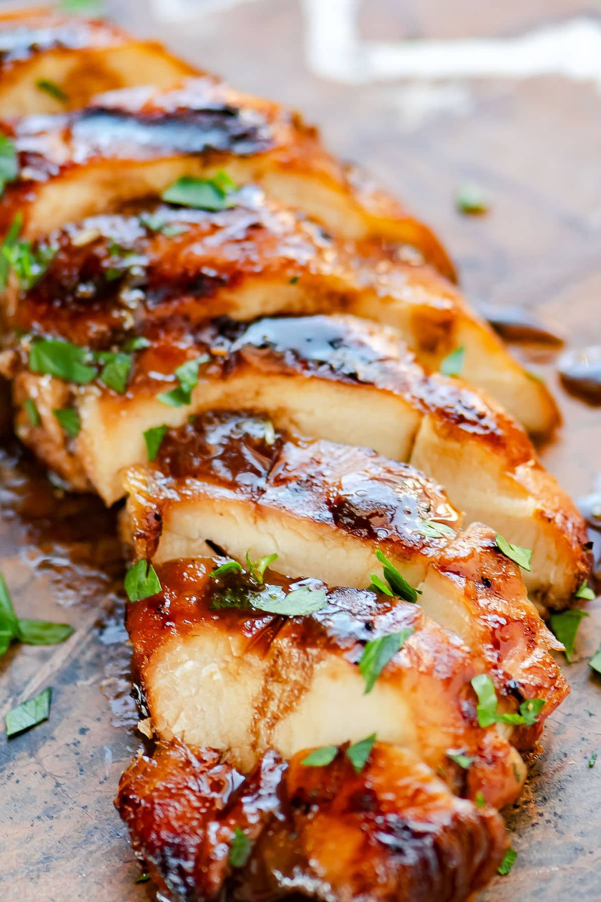delicious chicken breast that has been grilled after being marinated for hours. Topped with fresh parsley.