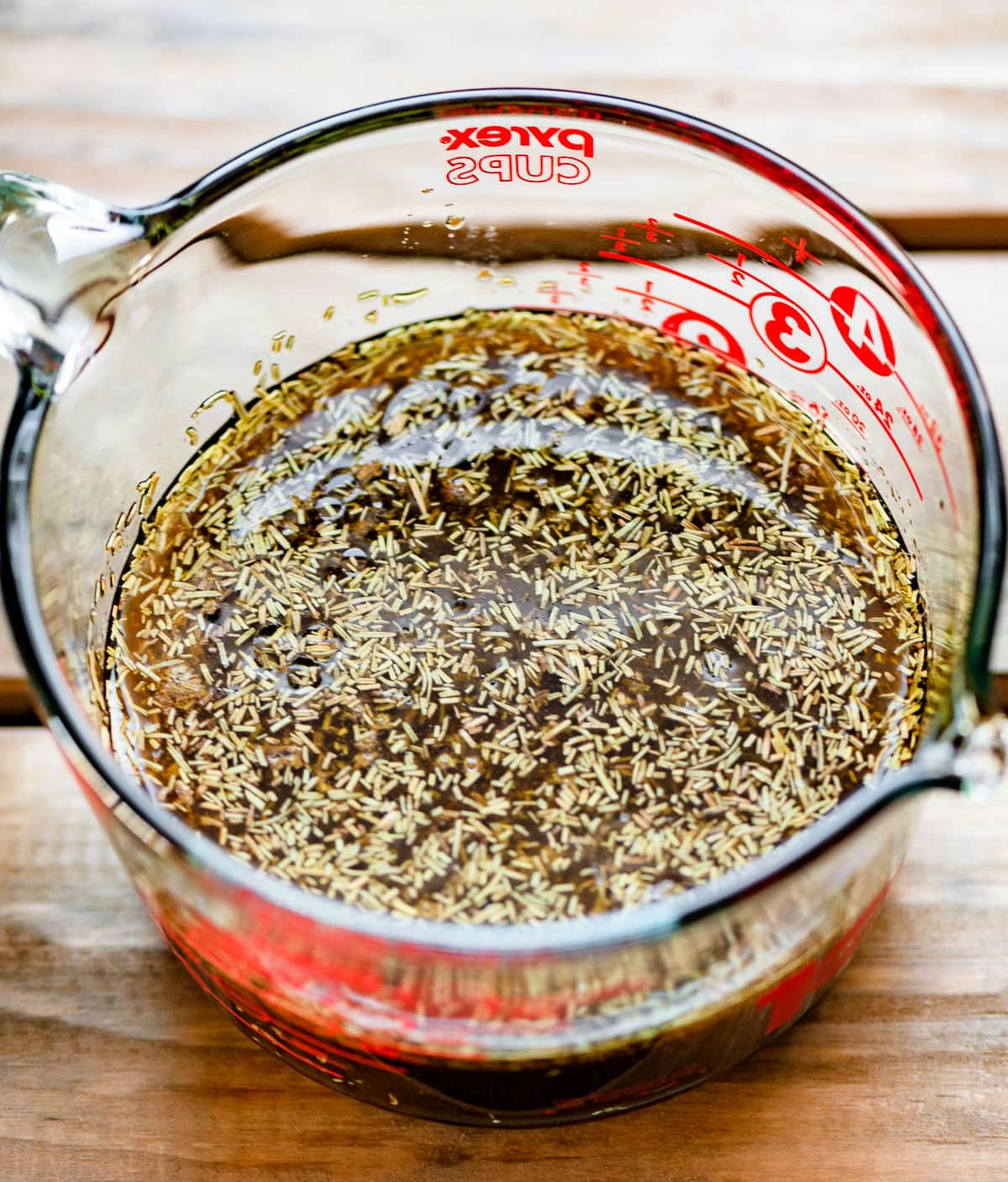 chicken marinade ingredients in a large glass measuring cup.