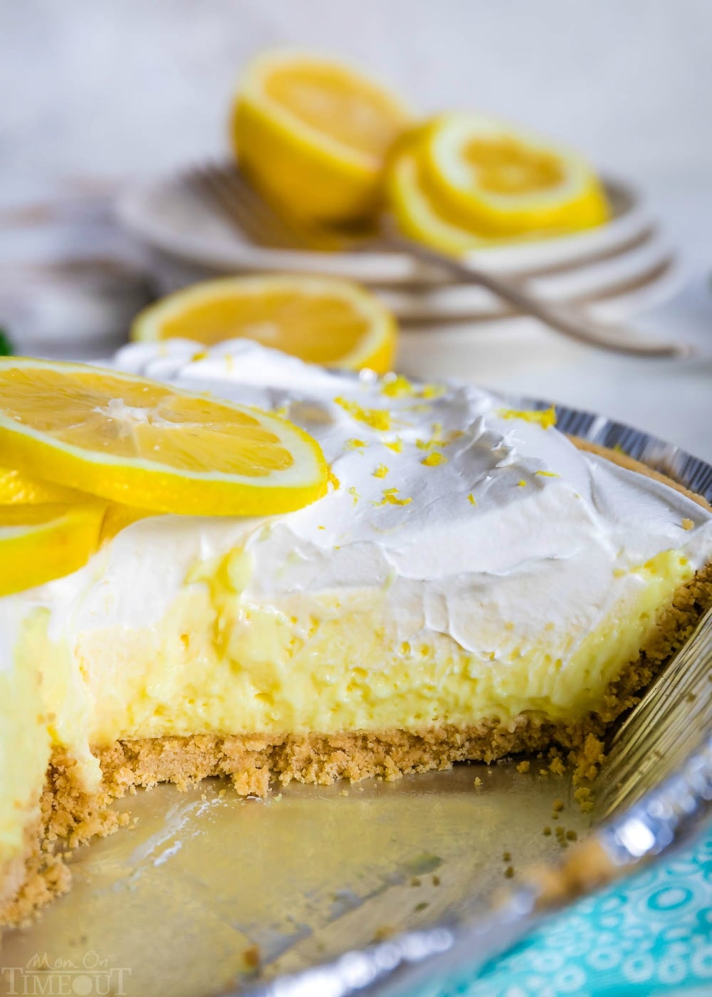 lemon pie in pie tin with a slice removed.