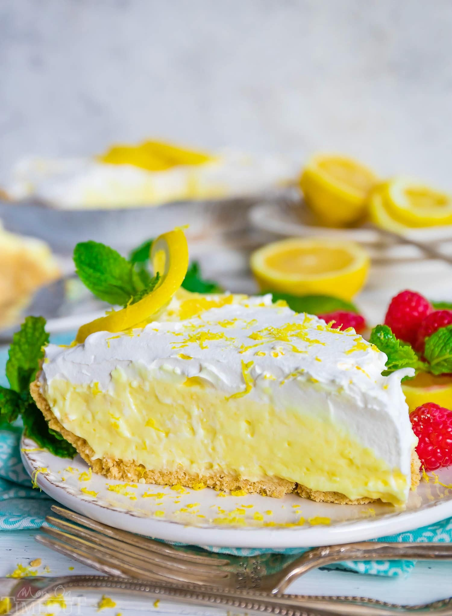 clean slice of creamy lemon pie served on a white plate.