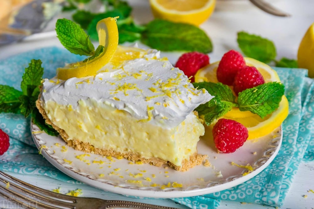 no-bake-lemon-pie-recipe-slice-garnish-with-lemon-twist-raspberries