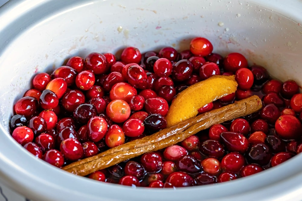 cranberry sauce ingredients stirred together in crockpot