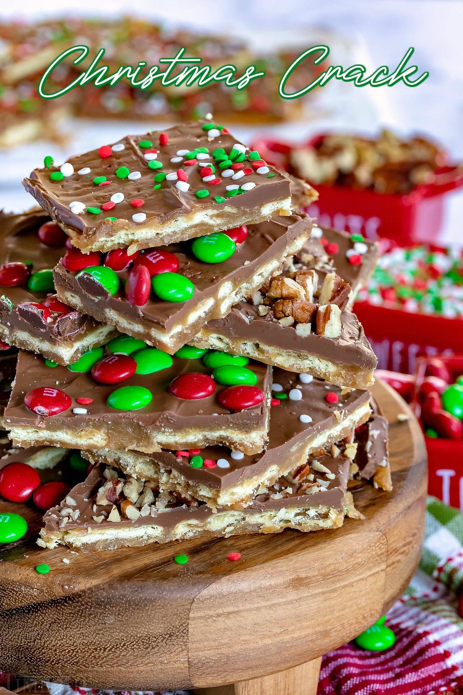 christmas crack recipe on wood stand piled high with nuts sprinkles mms 2