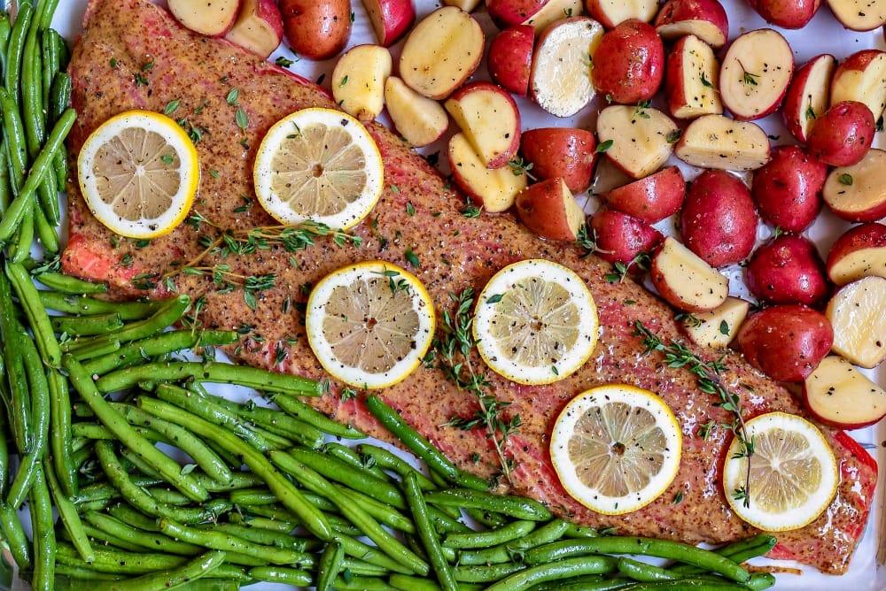 oven baked salmon recipe with honey dijon glaze on sheet pan