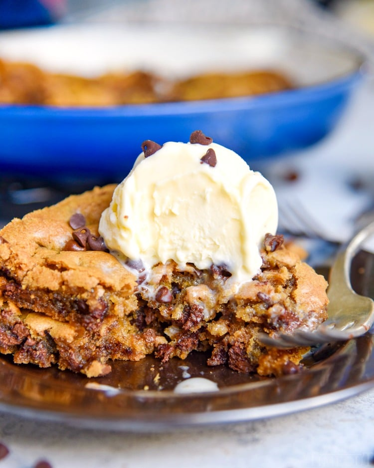 skillet cookie with chocolate chips and ice cream on plate