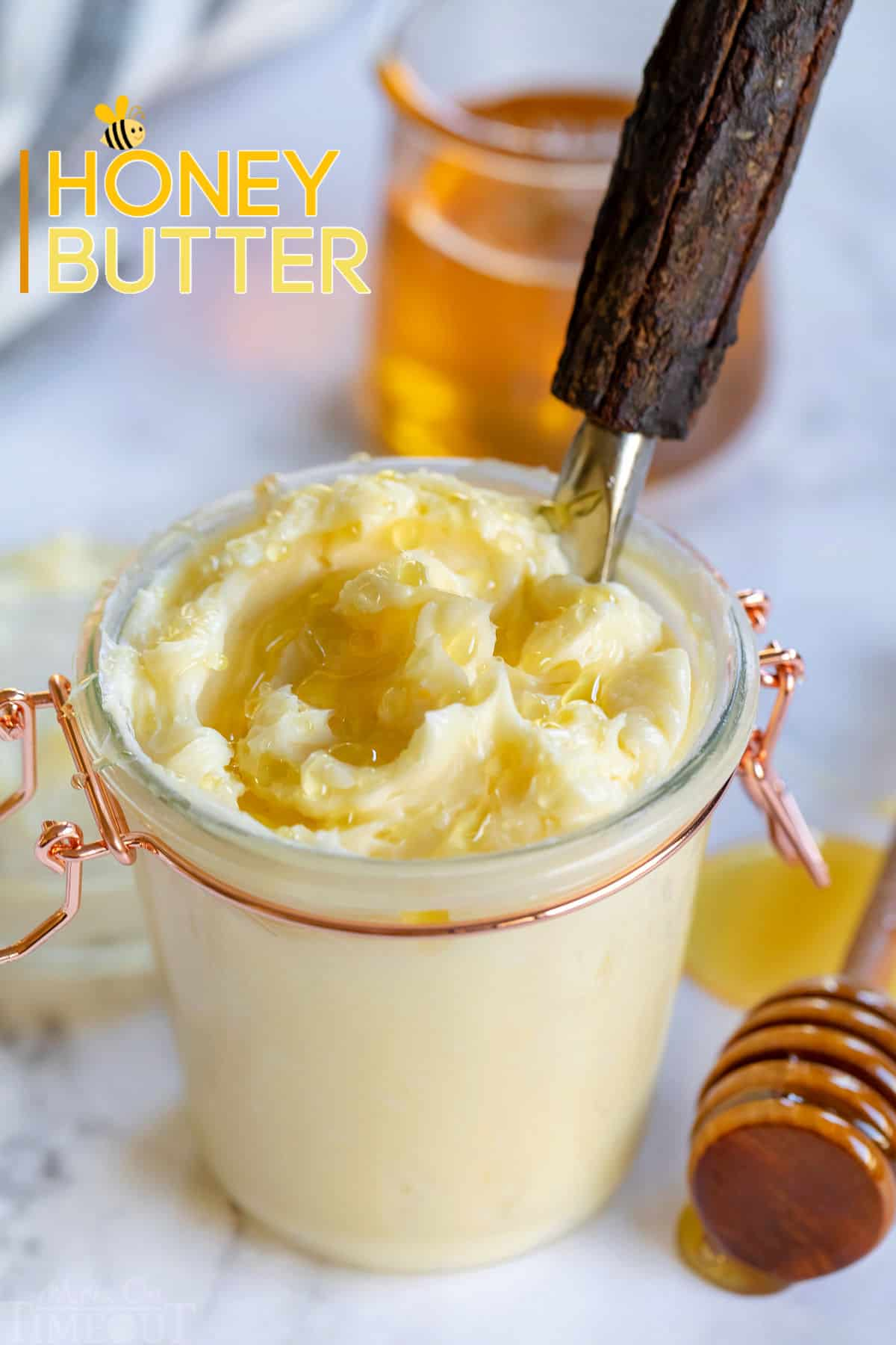 easy honey butter recipe in a glass jar with honey drizzled on top