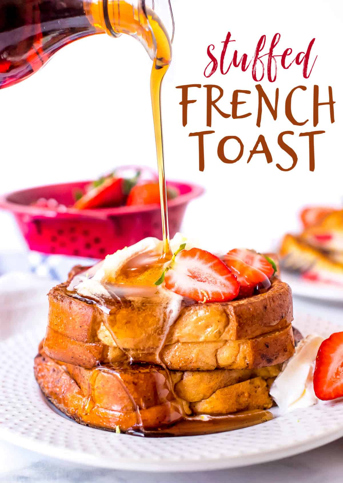 stuffed french toast recipe with cream cheese and strawberries on plate with syrup title
