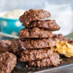 no bake cookies stacked on brown cutting board