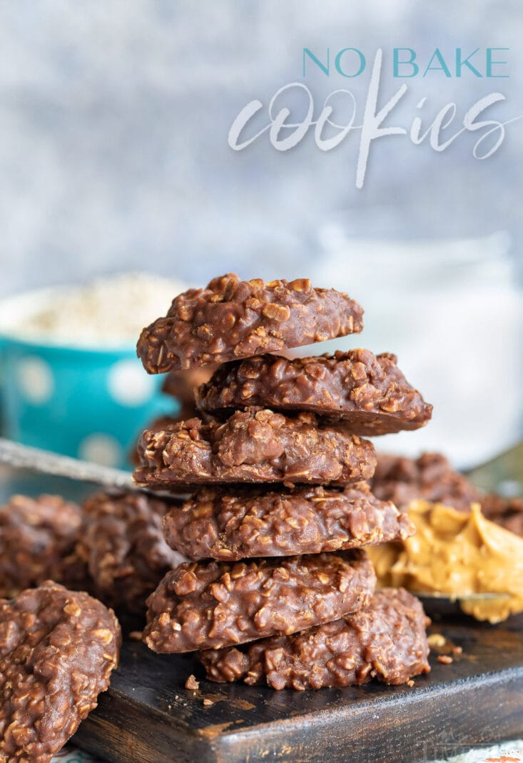 no bake cookies with chocolate oats and peanut butter on a dark cutting board stacked 5 high