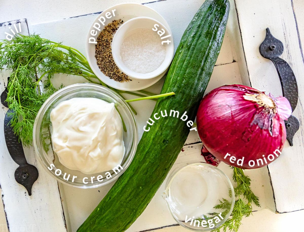 cucumber salad ingredients on a tray