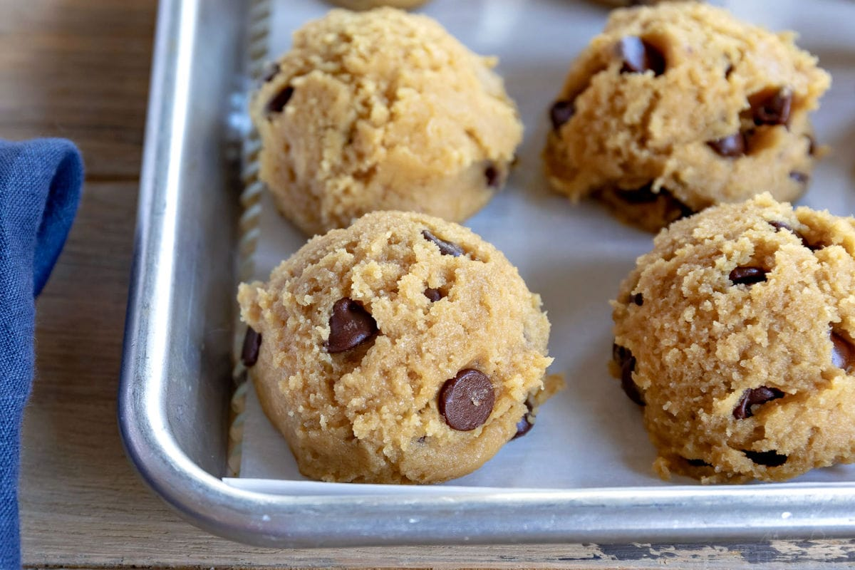 chewy chocolate chip cookies dough scooped onto baking sheet