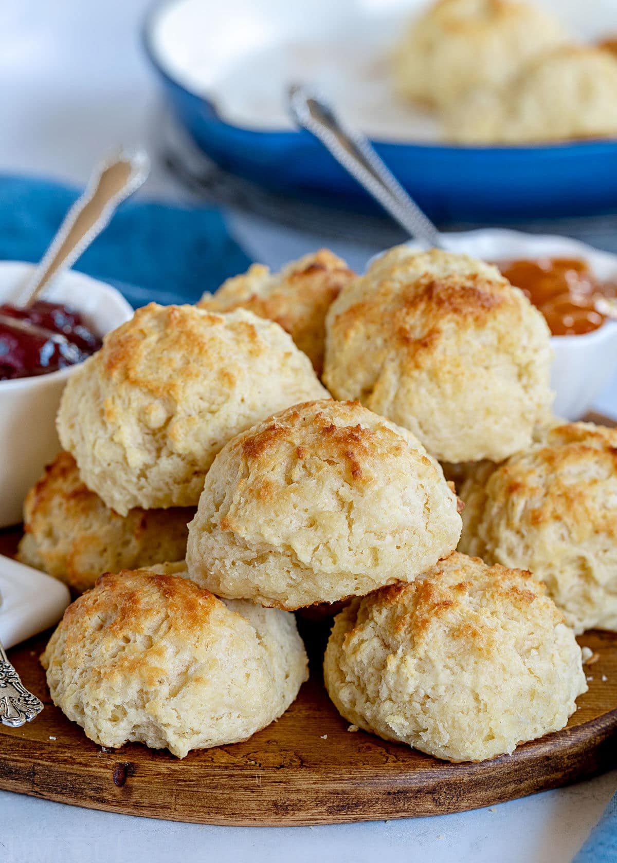 drop biscuits piled high on round wood board