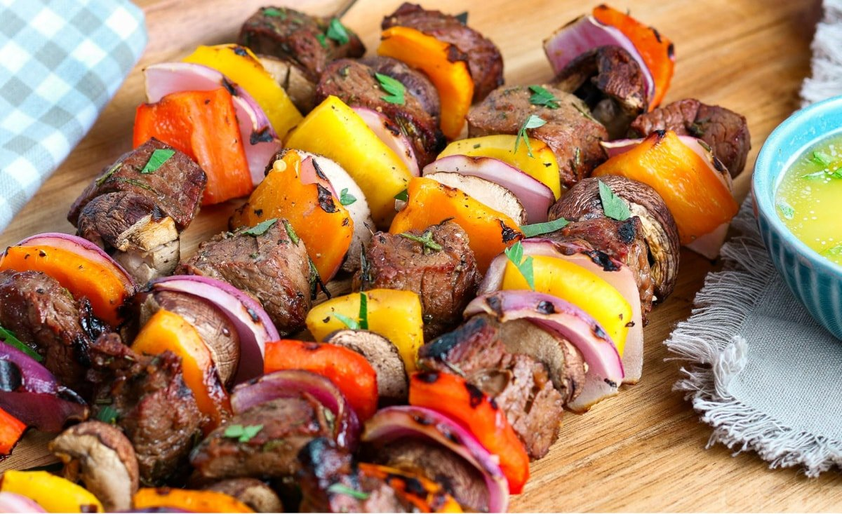 easy steak kabobs grilled and ready to eat on wood plate