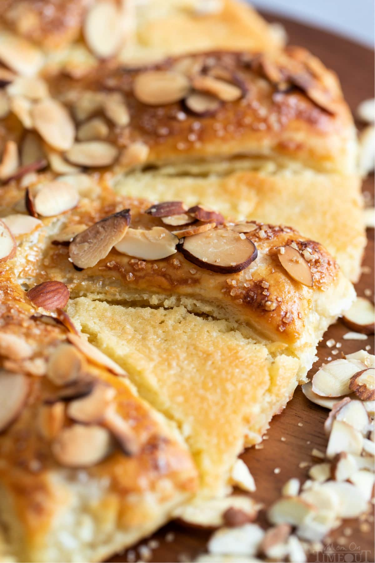 close up of bear claw pastry with almonds on top