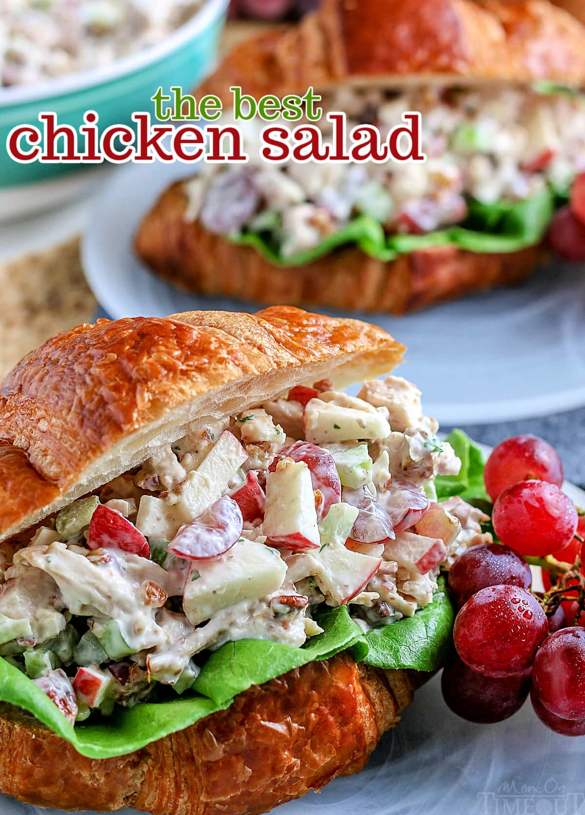 close up view of best chicken salad recipe served on croissant with grapes on the side and text overlay