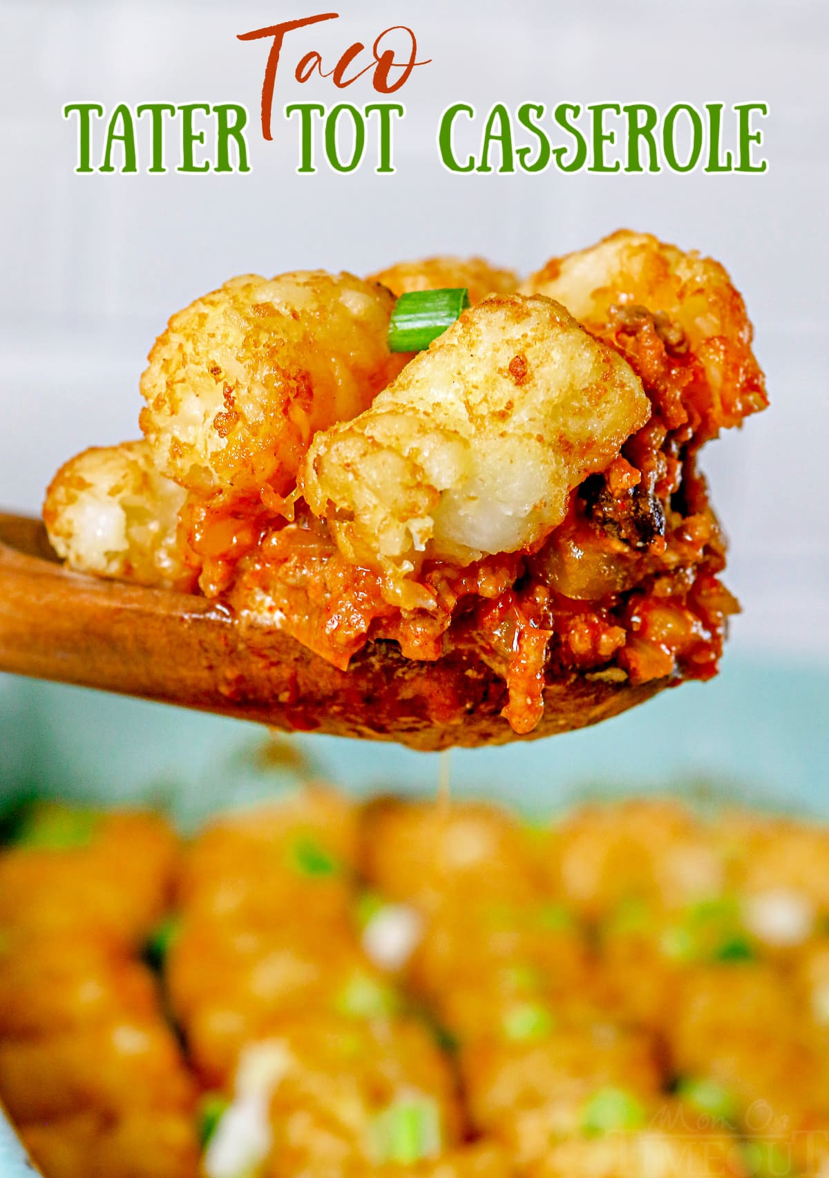 taco tater tot casserole being scooped out of dish with wood spoon with text overlay