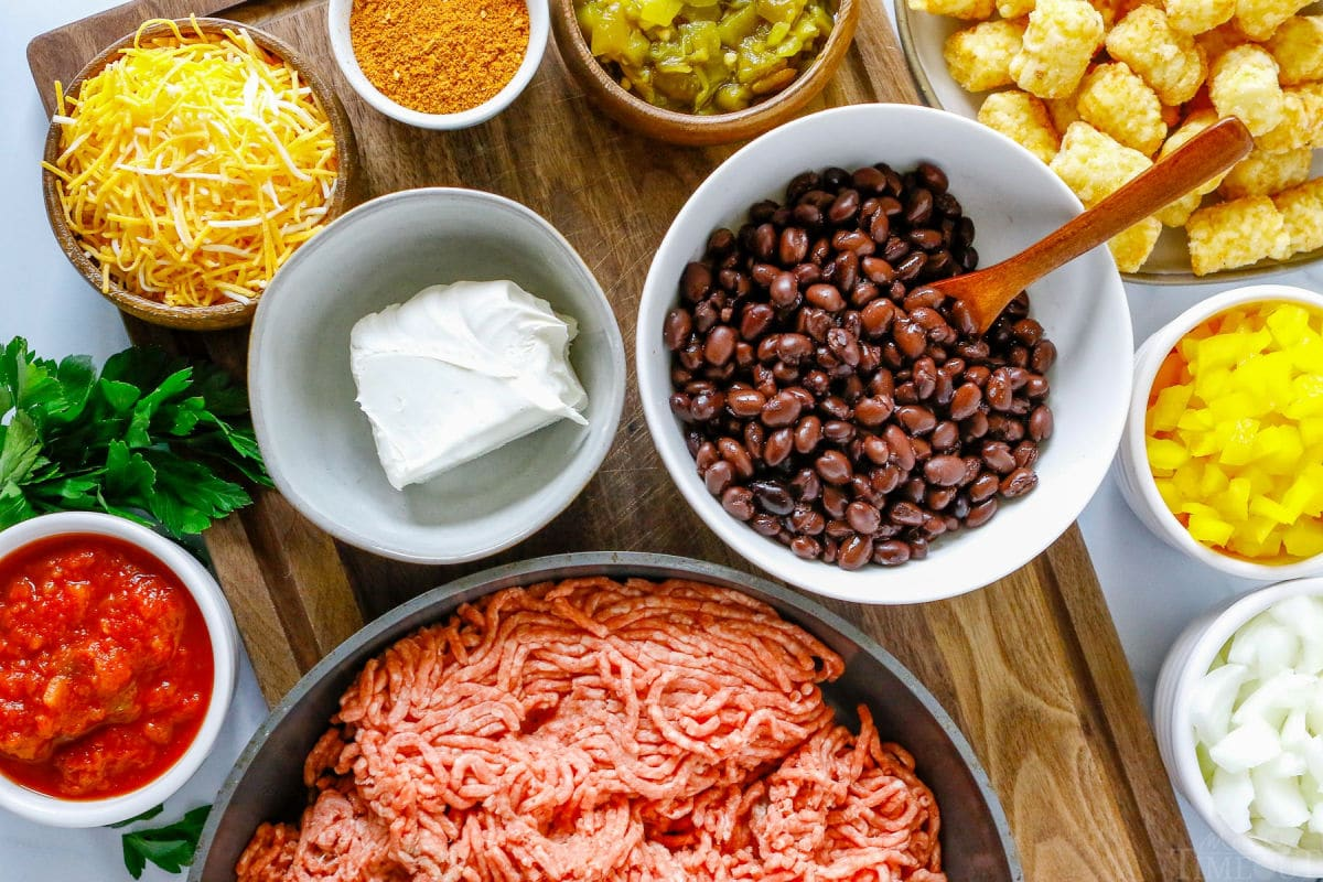 taco tater tot casserole ingredients measured out into bowls