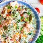 tortellini pasta salad in blue rimmed bowl square