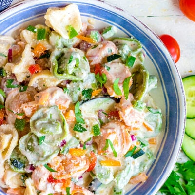 tortellini pasta salad in blue rimmed bowl square