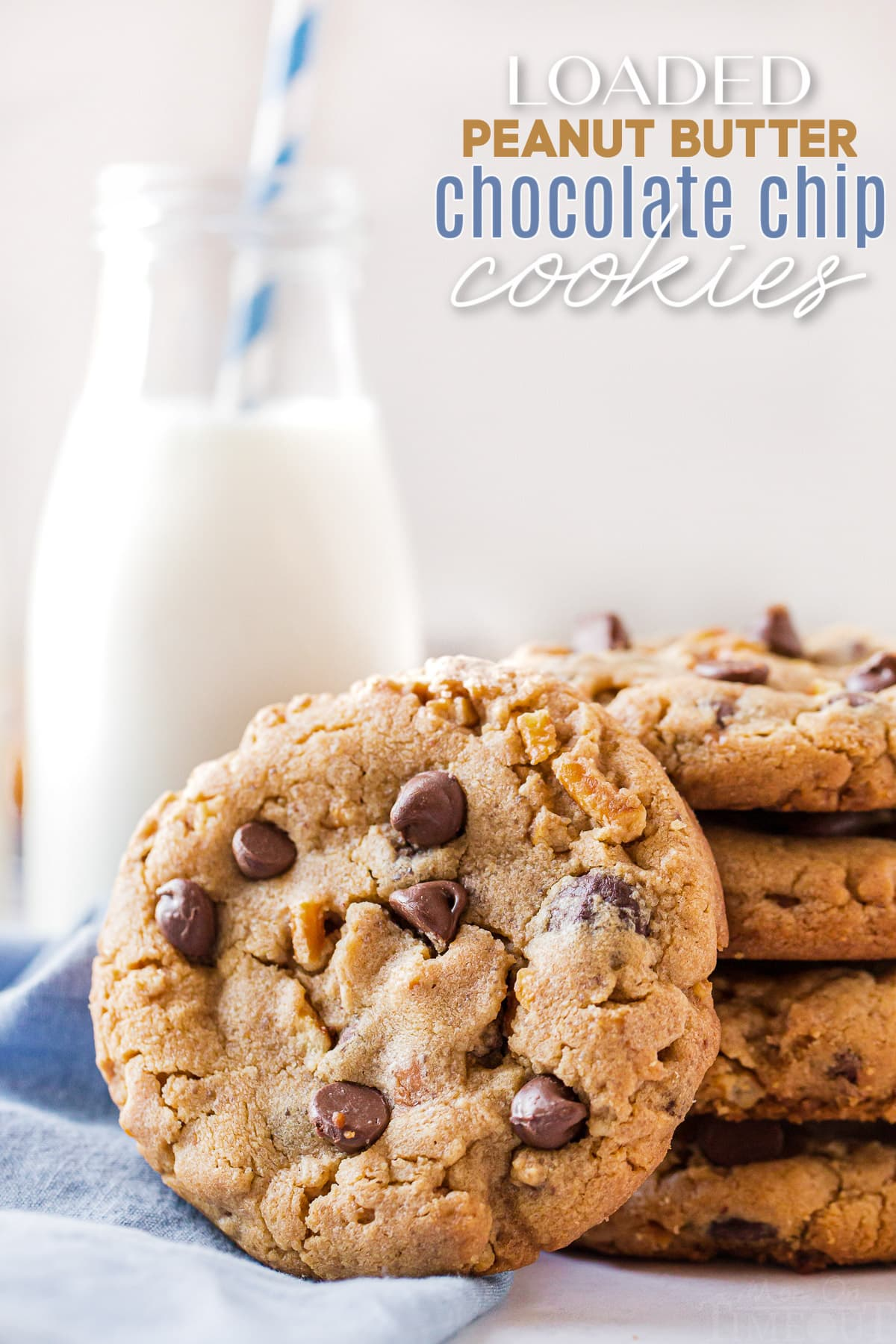 pretzel chocolate chip cookies stacked next to a blue napkin with milk jug in background and one cookie on it's side and text overlay at top