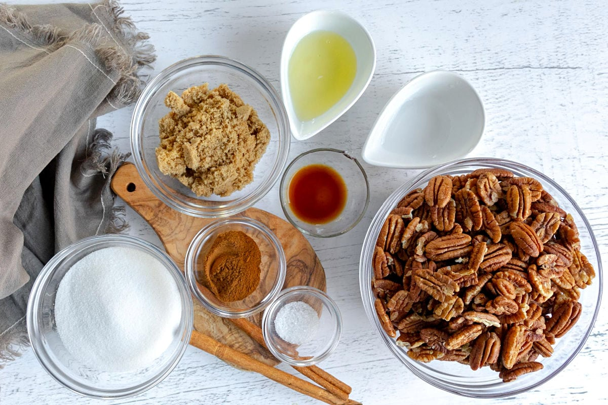 candied pecans ingredients measured out into small bowls sitting on white surface