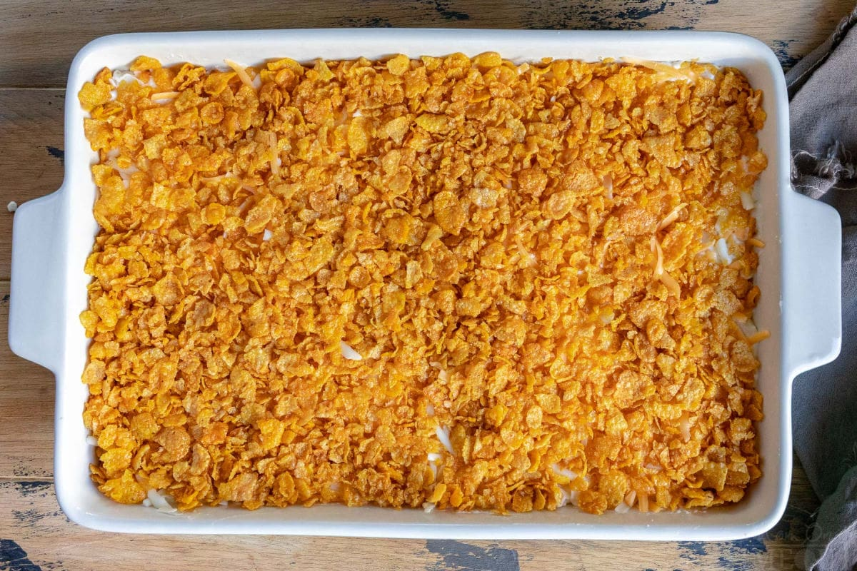 top down view of cheesy potatoes about to go in the oven with cornflake topping