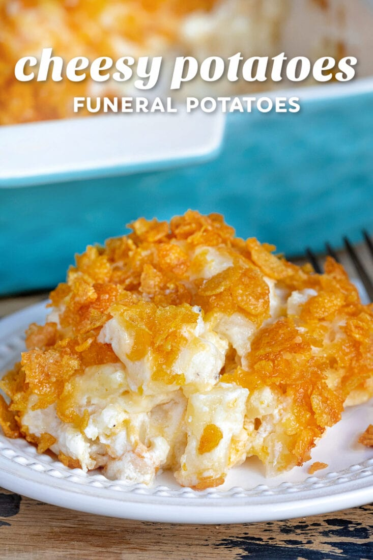 cheesy potatoes on a white plate with casserole dish in background and title overlay at top