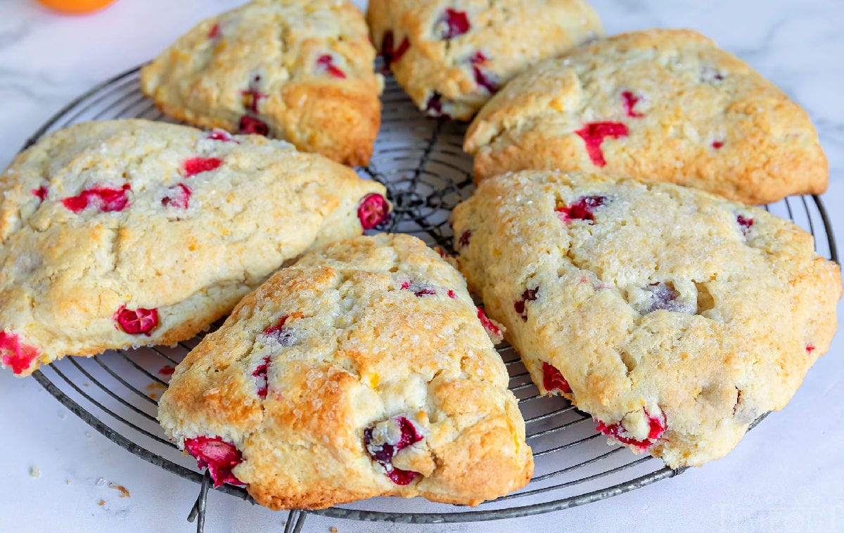 6 cranberry orange scones on cooling rack