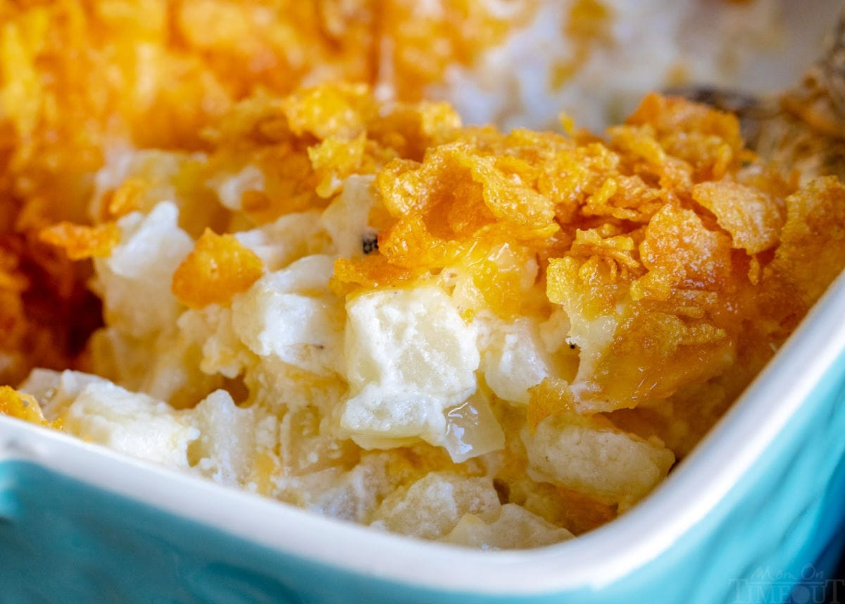 funeral potatoes in casserole dish with cornflake topping