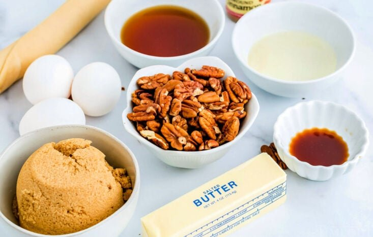 maple pecan pie ingredients measured out into small bowls