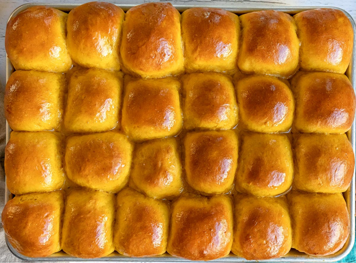 pumpkin rolls baked in sheet pan and brushed with butter